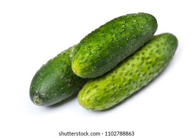 Few natural cucumbers isolated on white background