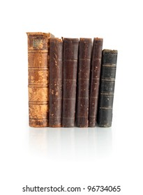 Few old books standing in a row on white background. Clipping path is included