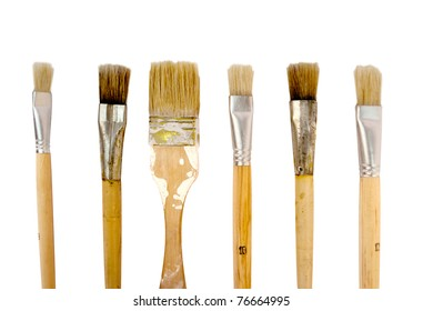 Few paintbrushes in a row, isolated on white.