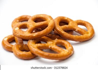 Few pretzels on a white background.
