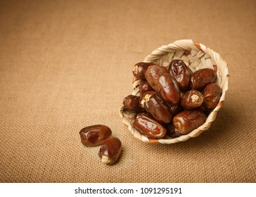 Few ripen finest quality Arabian dates in a handcrafted palm basket. Date is a staple fruit of middle east and africa.