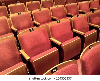 A few rows of empty theater seats