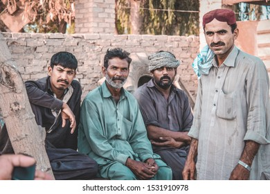 Few sindhi poor men seated on a wood made banch in a small village of sindh pakistan on 11/july/2019
