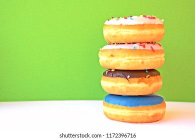 A few stacked donuts on a white background with a monochrome background