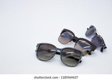 Few sunglasses. Many sunglasses. Eyewear. Few sunglasses isolated on a white background.