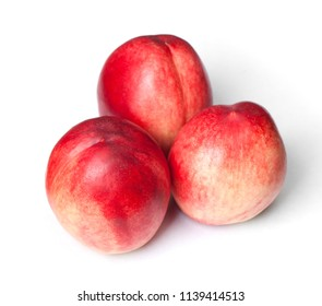Few tasty nectaines isolated on white background