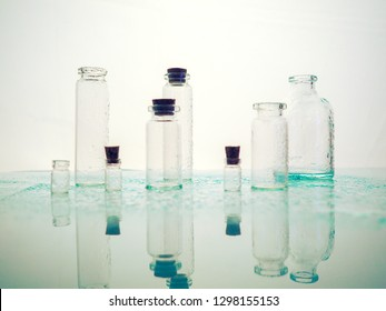 Few transparent bottles, water sprays. empty glass bottles