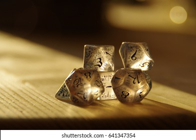 Few transparent rpg dice on table highlighted by the sun