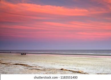 A few of us left, enjoying low tide on a calm January evening on the Hilton Head Island Beach, SC.