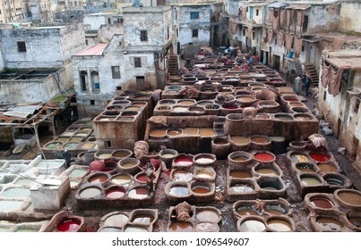 FEZ, MOROCCO - JANUARY 4, 2014: Men working hard in Chouara tannery souk in old town