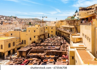 Fez, Morocco - May 07, 2017: Workers are dyeing leather at the tannery in Fez, Fes el Bali, Morocco, Africa
