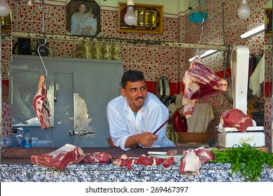 Fez, Morocco - May, 11, 2013: Butcher in an open air Moroccan market