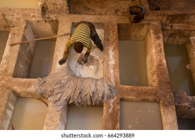 FEZ, MOROCCO - MAY 14, 2017: Worker in a traditional leather tannery.