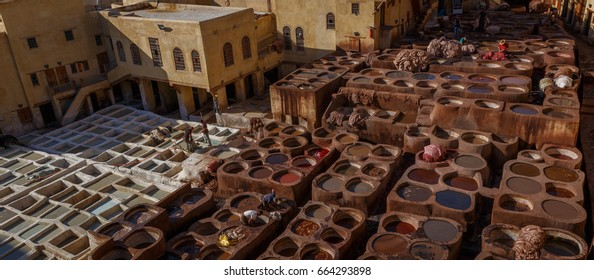 FEZ, MOROCCO - MAY 14, 2017: Workers in a traditional leather tannery.