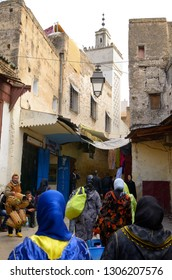 Fez, Morocco - November 19, 2011: Women in djellabas and head scarfs walking in the el Bali Medina of Fes Morocco
