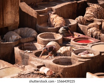 Fez, Morocco, November 2019: Men working at the leather Chouwara Tannery, in the Medina of Fez