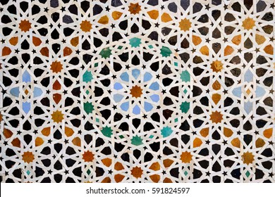 FEZ, MOROCCO - NOVEMBER 30: Detail of nice decorated walls in the Moroccan style  of the Madrasa Bou. Fez on November 30, 2015