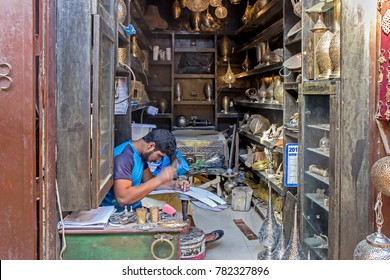 Fez, Morocco - October 24, 2017: Metalwork craftsman making lamp in workshop in Fez.
