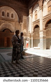 FEZ, MOROCCO-APRIL 23, 2014: Tourists in a Mosqe during a nice spring morning in the Medina of Fez on April 23, 2014