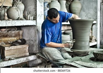 FEZ, MOROCCO-OCTOBER 24: Unidentified man makes a pottery in Fez, Morocco, on October 24, 2011. Fez is famous for its ceramics that are all handmade and hand painted.