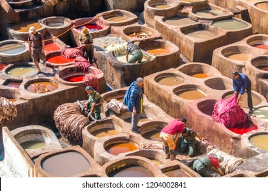 Fez/Morocco - February 22, 2018: Men working in the leather tanneries in Fez, Morocco.