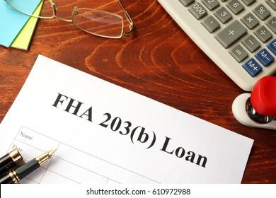 FHA 203b loan policy in an office.