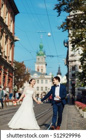 fiance and his beloved wife are on tram track