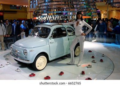 Fiat 500 with beautiful lady at Motorshow Bologna 2006