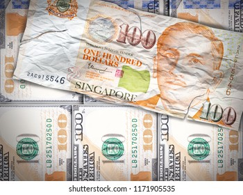 Fiat money bills crumbled lying over new strong currency bills.