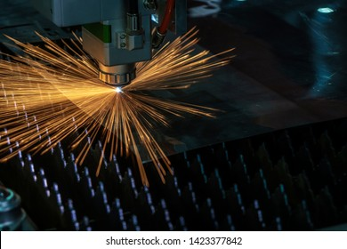 The fiber laser cutting machine control by CNC program. The modern sheet metal processing by laser cutting machine.