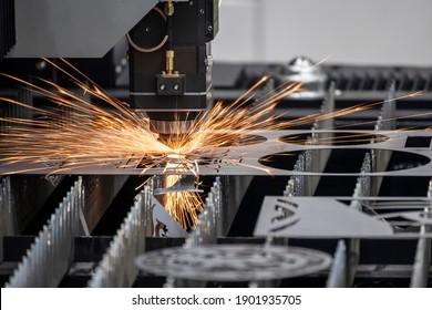 The fiber laser cutting machine cutting  machine cut the metal plate. The hi-technology sheet metal manufacturing process by laser cutting machine.