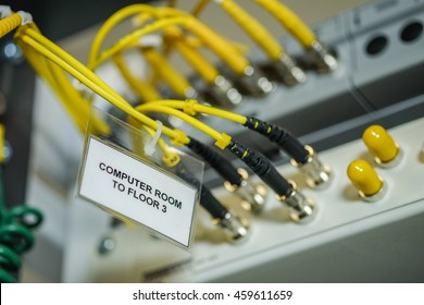 fiber optic cable connection to Network Server in a technology data center room . selective focus