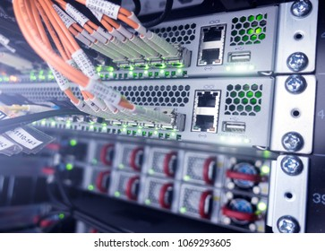 Fiber optic equipment in a data center. Close up fiber optic cable. Big data.  photo has a little noise