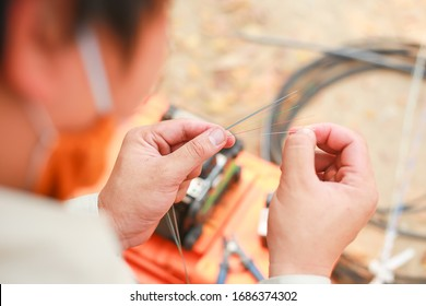 Fiber Optic Fusion Splicing Cable Internet signal and Wire connection with Fiber Optic Fusion Splicing machine,fiber optic cable splice machine in work - Shutterstock ID 1686374302