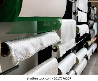 Fiberglass composite fabrics hanging on a wall dispenser