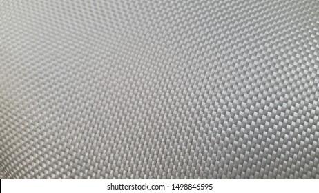 Fiberglass fabric. Abstract background. Fiberglass. Woven texture. Textured surface. Glass threads. Light fabric