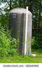 An fiberglass outhouse in a rustic campground.