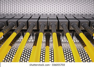 Fibre optic cable connected to an optic ports in a datacenter.