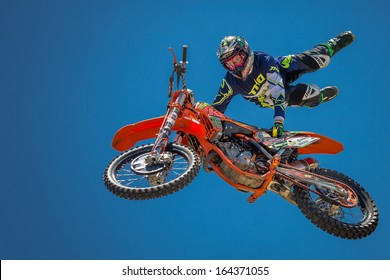 FICKSBURG, SOUTH AFRICA - NOVEMBER 23 : unidentified rider giving a free style motorcross acrobatics demonstration as part of Cherry Festival on November 23, 2013 in Ficksburg, South Africa