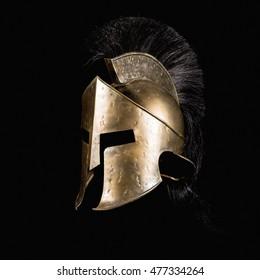Fiction Spartan helmet on black background.