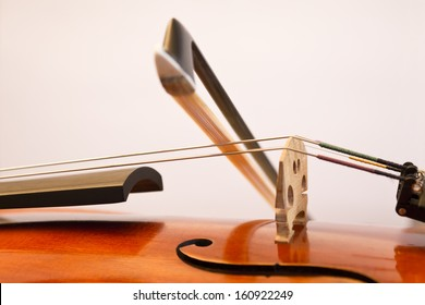 A fiddlestick (violin bow) on the violin string during playing.