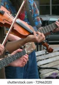 Fiddling Hands of Street Buskers in Downtown Asheville