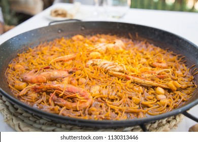 Fideua noodles of seafood in paella Denia Alicante Spain