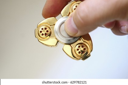Fidget spinner stress relieving toy in gold close up