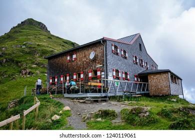 FIEBERBRUNN, AUSTRIA - AUGUST 8,2016. Wildseeloder Haus, mountain refuge hut with cozy accommodation  and Wildsee Lake ( Wildseelodersee ) above Fieberbrunn in the Kitzbuhel Alps, Tirol, Austria