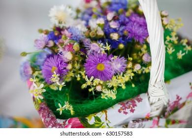 Field beautiful flowers in a wicker basket