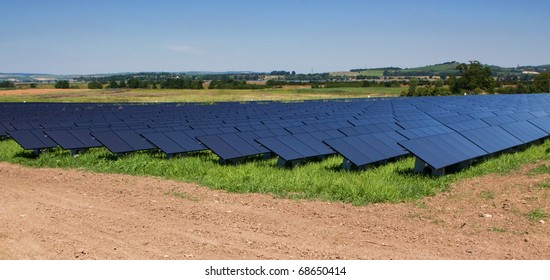 Field with black solar panels.