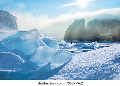 Field of blue ice and rocks with sun