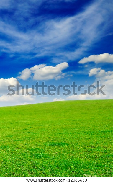 field and the blue sky covered by clouds
