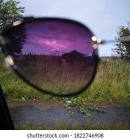 Field caught through pair of tinted sunglassses